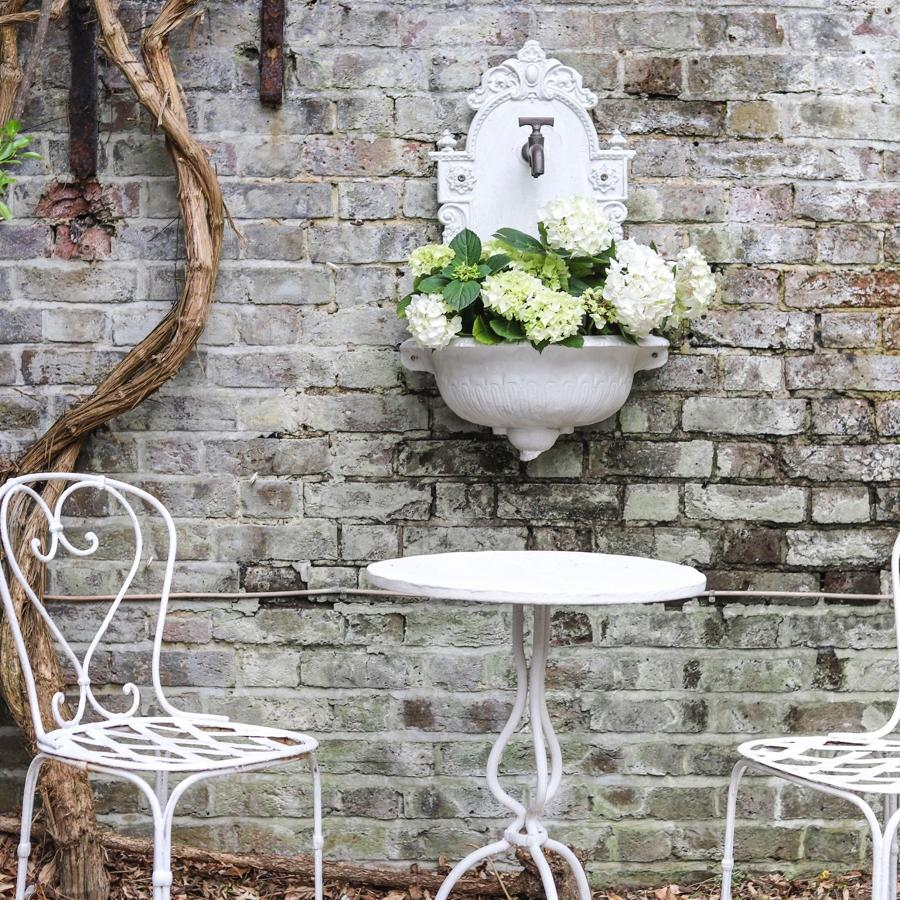 Antique French painted iron garden table and chairs