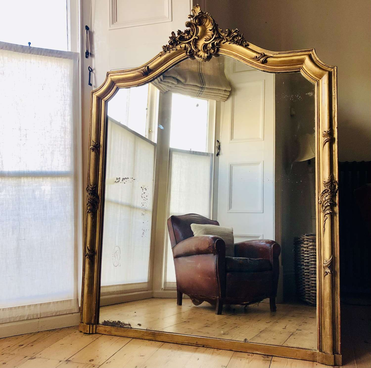 Large antique French gilt Louis XV leaner mirror overmantel