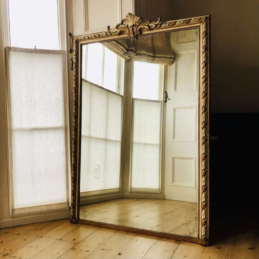 Antique French gilt and gesso leaner mirror