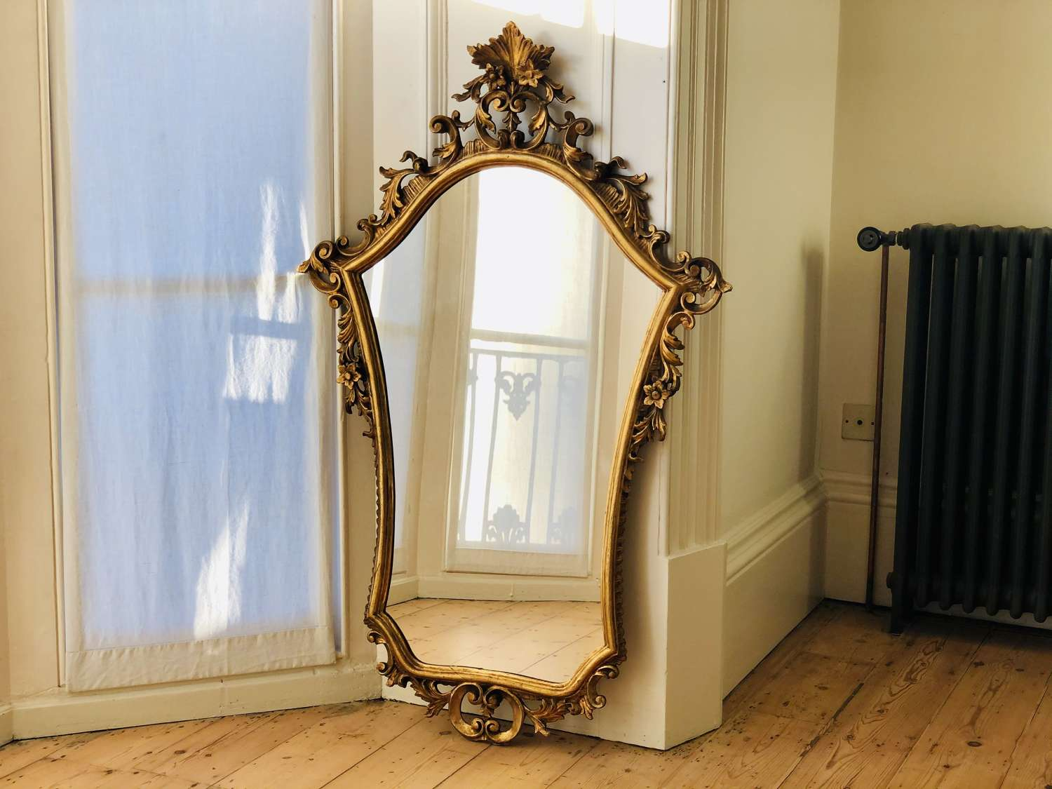 Antique Italian gilt mirror