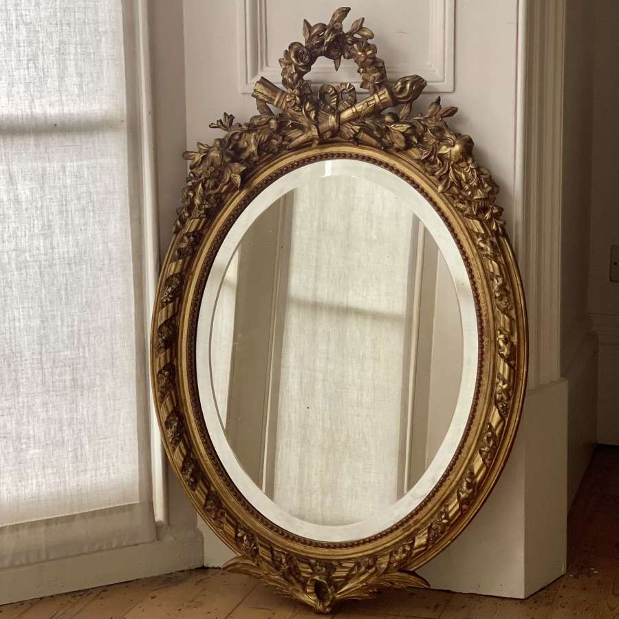 Antique French gilt oval mirror