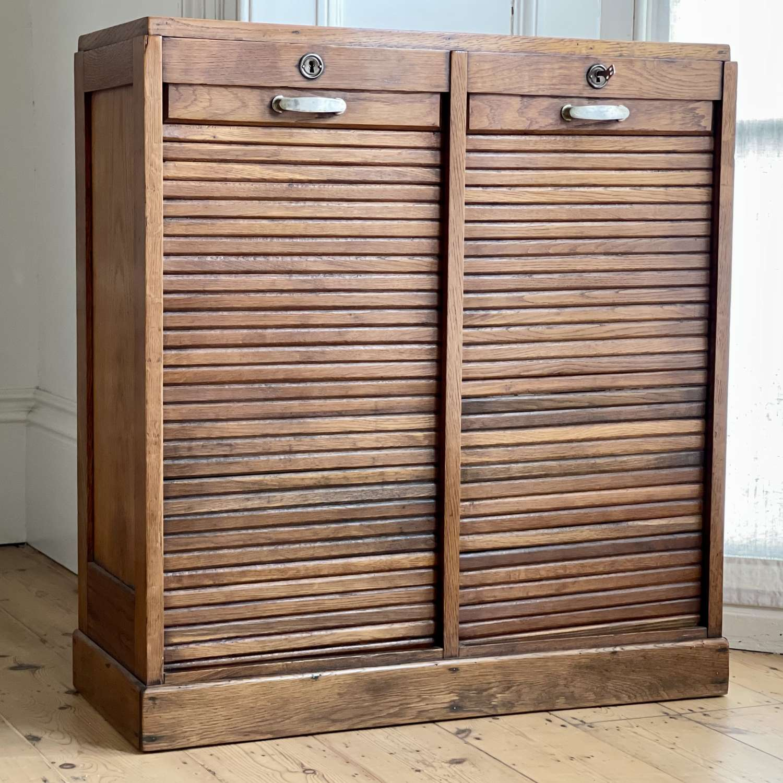 Antique French oak double tambour cabinet