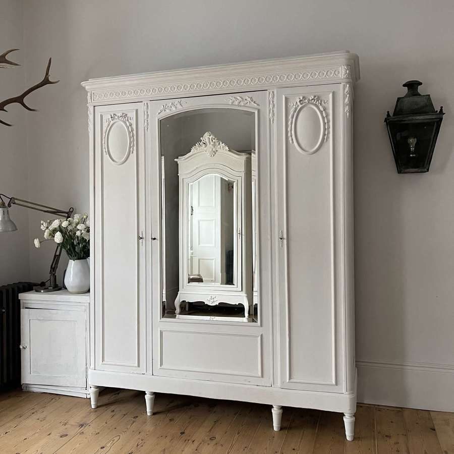 Antique French triple armoire with hanging rails
